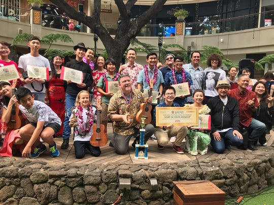 Richard Maxson, center, of Springfield was victorious in February at the Eighth Annual International Ukulele Contest in Honolulu. He won for best performance and for best original song.