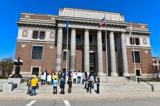 Poultry workers and advocates gather in front of the Stearns County Courthouse Thursday, April 25, in St. Cloud.