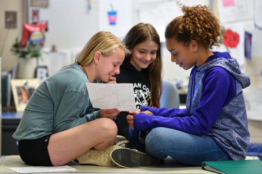 Fifth grade students collaborate on a project Thursday, April 25 at Rice Elementary School.