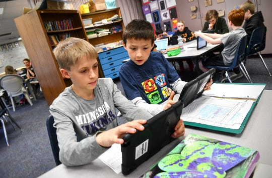 Fifth grade students Oliver Froelich and Christian Gable work on their project centered on causes and solutions for pollution during a group project session Thursday, April 25 at Rice Elementary School. The school was recently authorized to teach the International Baccalaureate Primary Years Programme. In Minnesota, just 24 schools qualified to teach the globally focused curriculum.