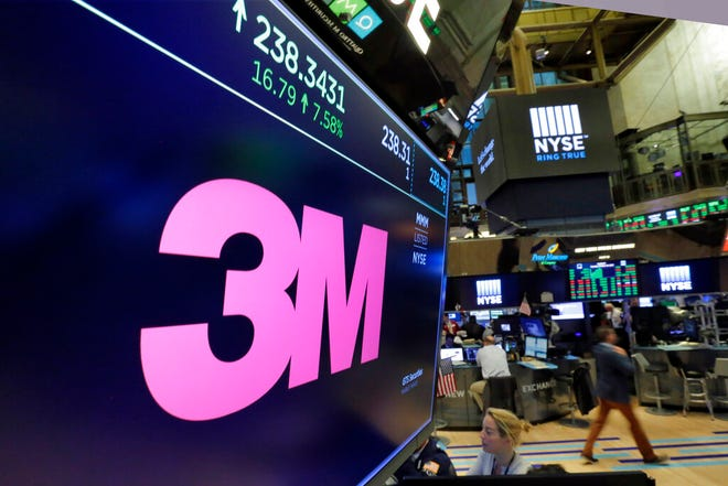 In this Oct. 24, 2017, file photo, the logo for 3M appears on a screen above the trading floor of the New York Stock Exchange. 3M plans to cut 2,000 globally as part of a restructuring due to a slower-than-expected 2019.