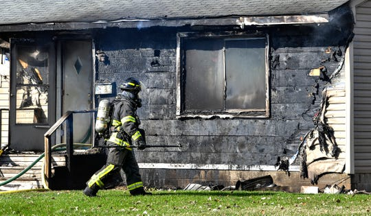St. Cloud firefighters respond Thursday, April 25, to the scene of a house fire at 614-12th Ave N in St. Cloud.