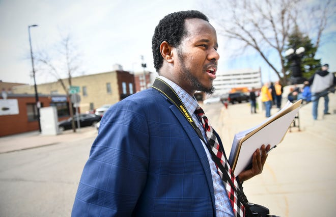 Greater Minnesota Worker Center Executive Director Ahmed Ali speaks during a rally in St. Cloud Thursday, April 25.