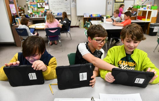 Fourth grade students research topics of interest to them in small groups Thursday, April 25 at Rice Elementary School.