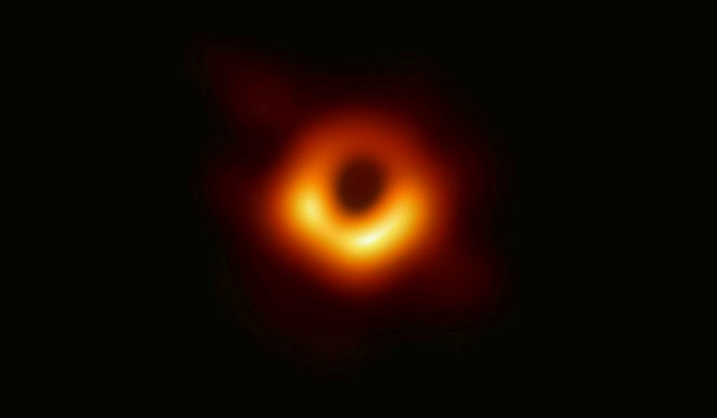This false-color image released Wednesday, April 10, 2019 by the Event Horizon Telescope shows a black hole at the center of the Messier 87 galaxy. Scientists revealed the first image ever made of the mysterious stellar phenomenon after assembling data gathered by a network of radio telescopes around the Earth. It is located about 53 million light years away. (Event Horizon Telescope Collaboration/Maunakea Observatories via AP)
