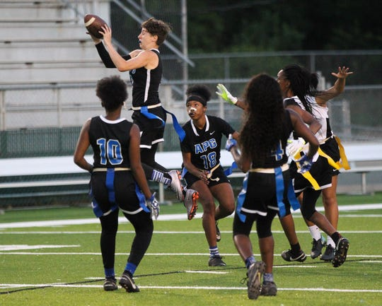 Godby senior Kaylene Colburn makes a leaping interception as Godby beat Lincoln 19-6 during the district championship game at Gene Cox Stadium on April 24, 2019.