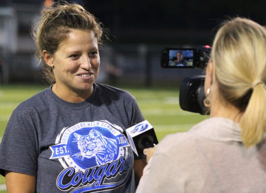 Godby flag football coach Chelsea Parmer gets interviewed after the Cougars beat Lincoln 19-6 during the district championship game at Gene Cox Stadium on April 24, 2019.