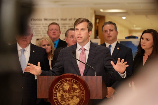 Rep. Jay Trumbull speaks during a news conference held to discuss Hurricane Michael recovery funding as budget negotiations continue at the Capitol on April 25. Trumbull, a Panama City Republican, is leading the issue of toll roads in the House.