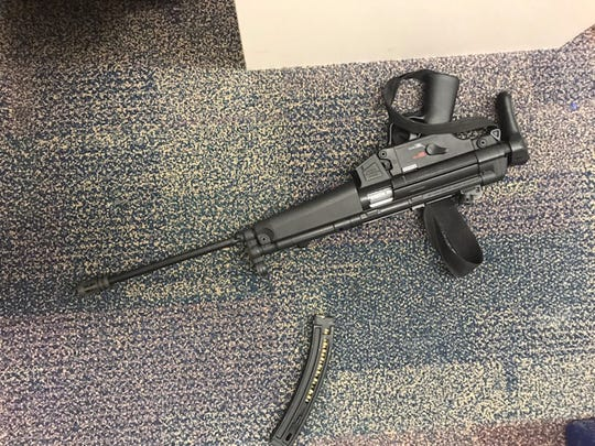 The rifle a Jensen Beach man is accused of using to threaten a pharmacist over narcotics.
