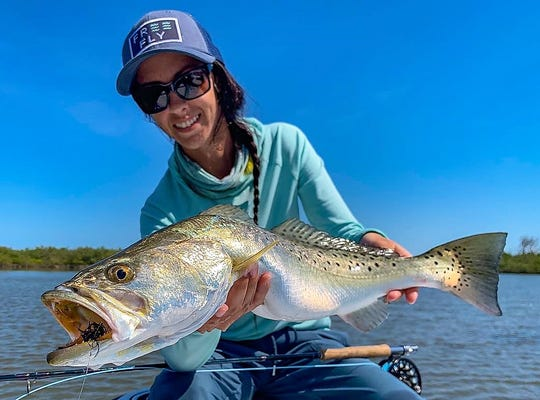 Erin Courtney of New Smyrna Beach landed a well-placed fly where this spotted seatrout grabbed it April 24 while fishing in the Mosquito Lagoon with Capt. Billy Rotne.
