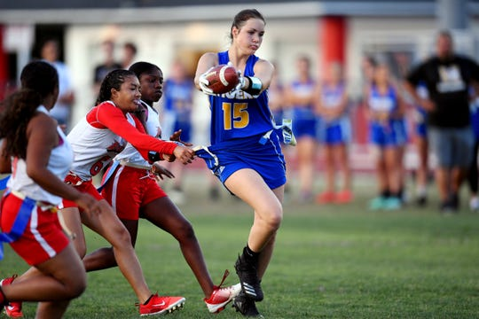 Martin County High School's Hana Connolly stretches for the end zone Wednesday, April 24, 2019 during the District 4-2A flag football championship against St. Lucie West Centennial at South Fork High School. Martin County won the game 25-0 to claim the title.