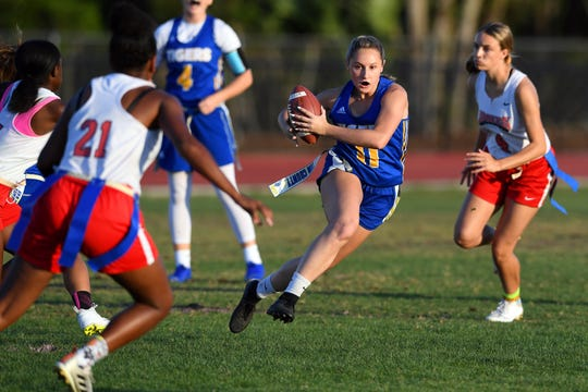 Martin County's Lizzy Spears looks for running room during the District 4-2A flag football championship game against St. Lucie West Centennial on April 24, 2019.