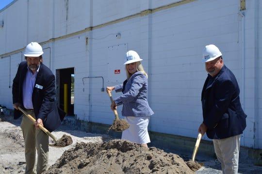 Vero Beach City Council members Mayor Val Zudans, left, Laura Moss and Robert Brackett help celebrate the start of construction on the New Up Center.