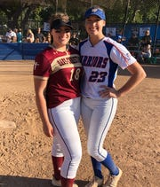 Oaks Christian's Taylor Johnson and Westlake's Alexa Campbell, who began playing softball together in Thousand Oaks at age 7, pose after Westlake's Senior Day on Wednesday.