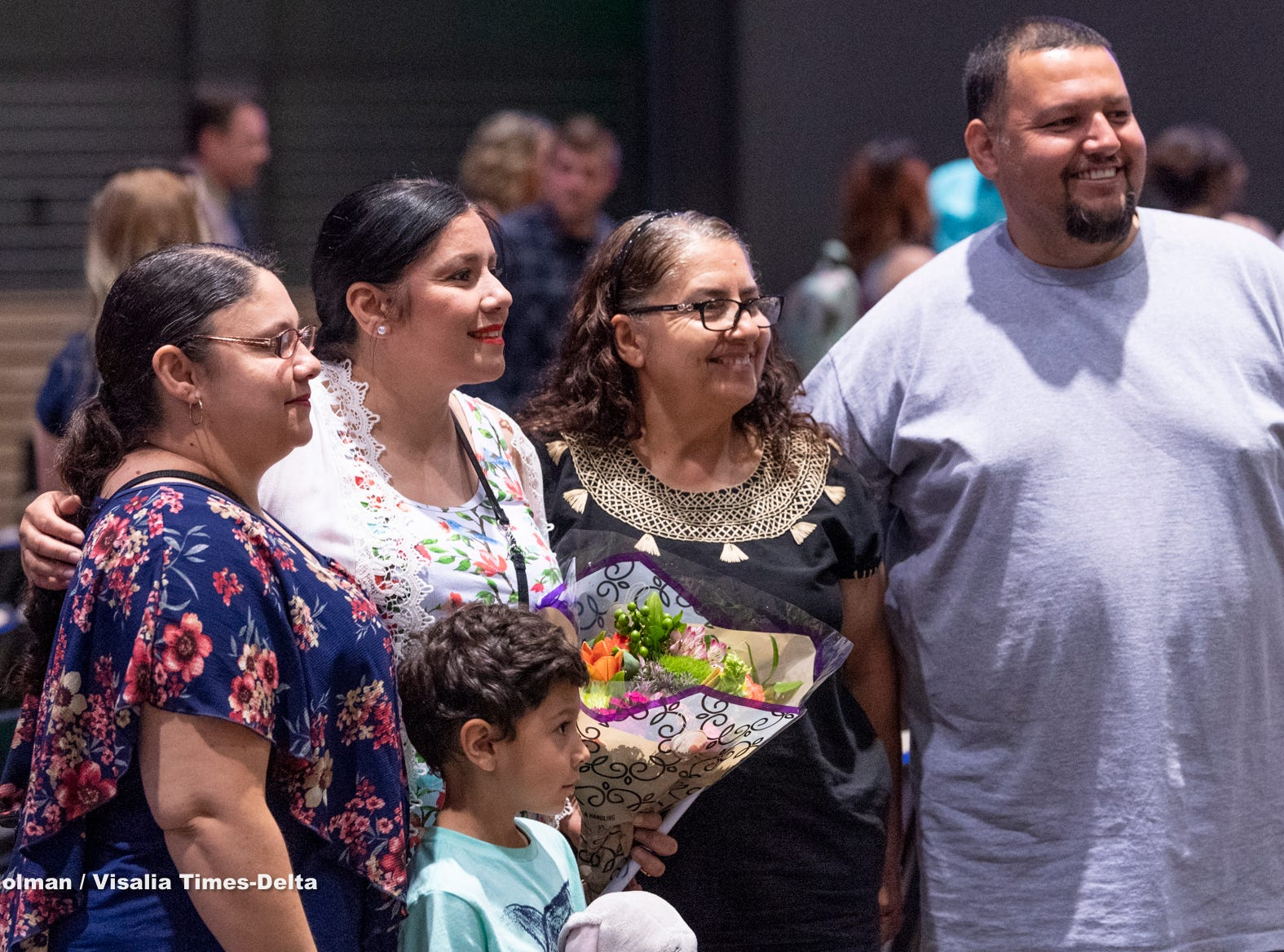 Graduate Dora Uribe, second from left, poses for pictures after the Tulare County Adult Drug Court Graduation & Commencement Ceremony on Wednesday, April 24, 2019.