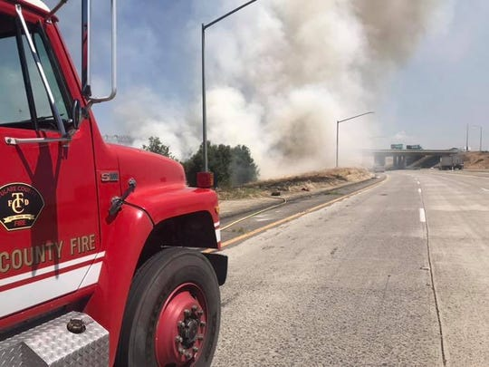 Fire crews are on scene of a grass fire at Highway 198 and Highway 99.