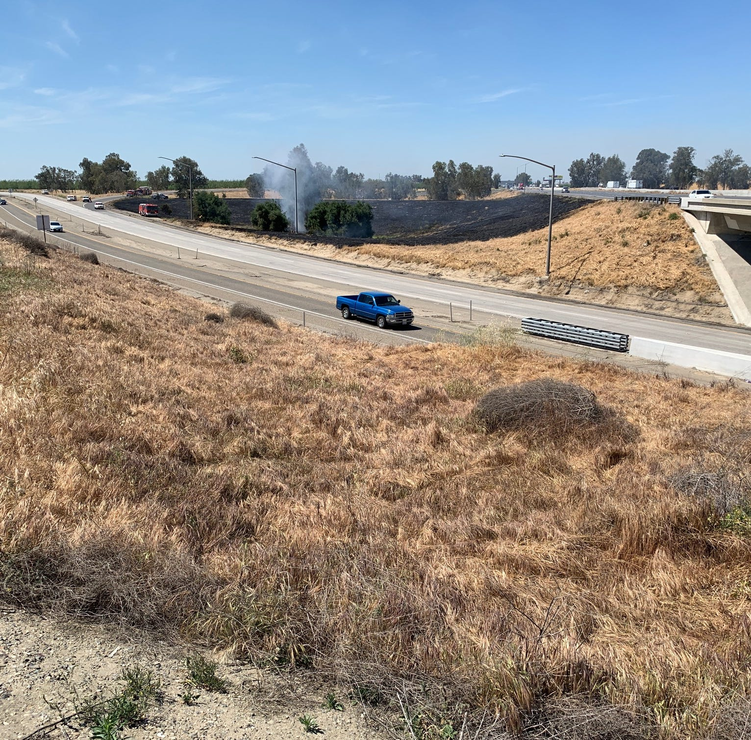 BREAKING: Brush fire forces firefighters to close portions of Highway 198