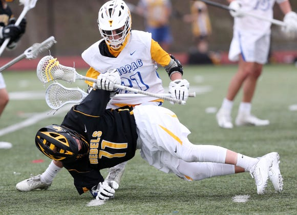 Lakeland/Panas' Mason Nocito (11) controls the ball despite pressure from Mahopac's Zach Esteves (21) during boys lacrosse action at Mahopac High School April 25,  2019.