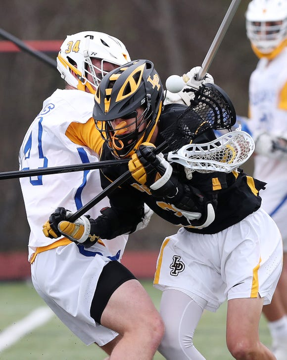 Lakeland/Panas' Mike Walsh (3) has the ball knocked away by Mahopac's Timmy Cegelski (34) during boys lacrosse action at Mahopac High School April 25,  2019.