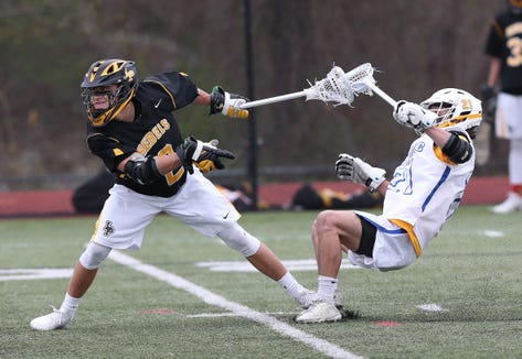 Lakeland/Panas' Matt Maker (2) fires a shot for a first half goal in front of Mahopac's Zach Esteves (21) during boys lacrosse action at Mahopac High School April 25,  2019.