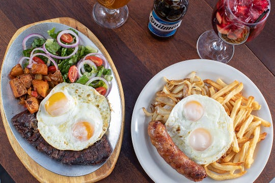 Brunch dishes at Manhattan's Buenos Aires Restaurant; on left, the grilled skirt steak with two organic fried eggs and the homemade Creole sautéed sausage with mix sautéed vegetables on right.