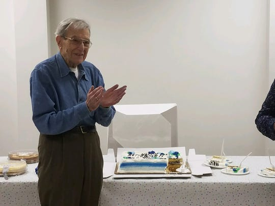 Nat Oberman standing by his retirement cake during a party for him at Ramapo Town Hall in March 2018
