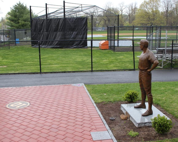 A life-sized statue of longtime Eastchester baseball coach Dom Cecere overlooks the Eastchester High School baseball field. The community will officially unveil the memorial during the sixth annual Dom Cecere Classic on April 27, 2019.