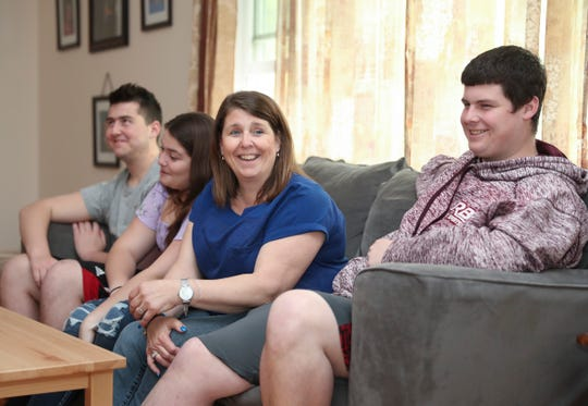 Leona Parent, center, with children James, 20, Brylee, 15 and Freddy, 23, talks about making the decision to donate the kidneys of her husband in New City home on Thursday, April 25, 2019.  Clarkstown Police detective Fred Parent passed away in November of 2017 after a brief illness, his family made the decision to donate his organs.