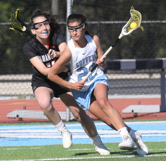 Suffern's Kate Burns (22) drives with the ball as Mamaroneck's Erin Cotter defends during Suffern's 12-9 win over the Tigers April 24, 2019 at Suffern Middle School.