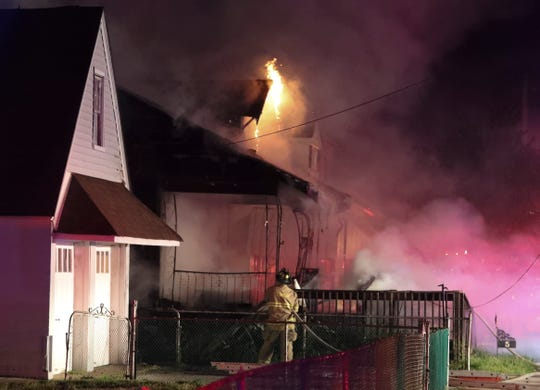 Firefighters extinguish a blaze that severely damaged a home near Elsmere in April. Homeowner Debbie Purdue, 63, was badly injured in the fire when she reentered the house to search for her cat, according to her son. Purdue died Saturday at Crozer-Chester Medical Center.