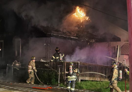 Firefighters extinguish blaze that severely damaged a home near Elsmere early Thursday. Firefighters found heavy flames on the front of the home as they arrived at the scene on the first block of W. Summit Avenue, reported at 1:35 a.m.
