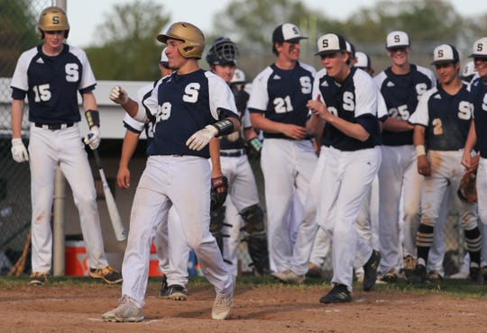 Salesianum's Brendan Pacheco (29) touches home after his two-run home run in the sixth inning of Salesianum's 8-0 win at St. Mark's Wednesday.