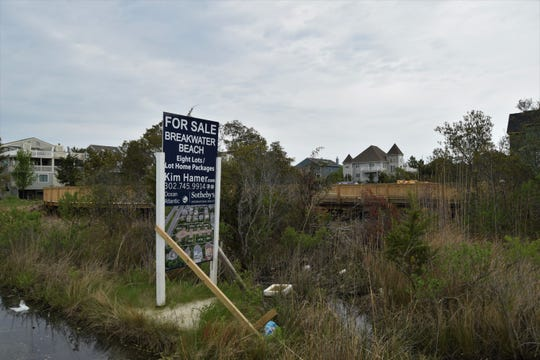 A sign advertises the eight lots for sale on the oceanside of Del. 1 north of Bethany, where a boardwalk road and driveways were built over an unprotected wetland.