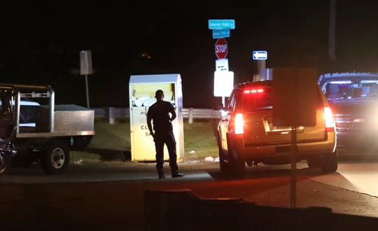 A member of the state fire marshal's office investigates after a person was injured by an explosive device outside a Claymont auto repair shop late Wednesday evening. An explosion was reported about 10:45 pm in front of the Governor Printz Boulevard shop, one person was hospitalized.