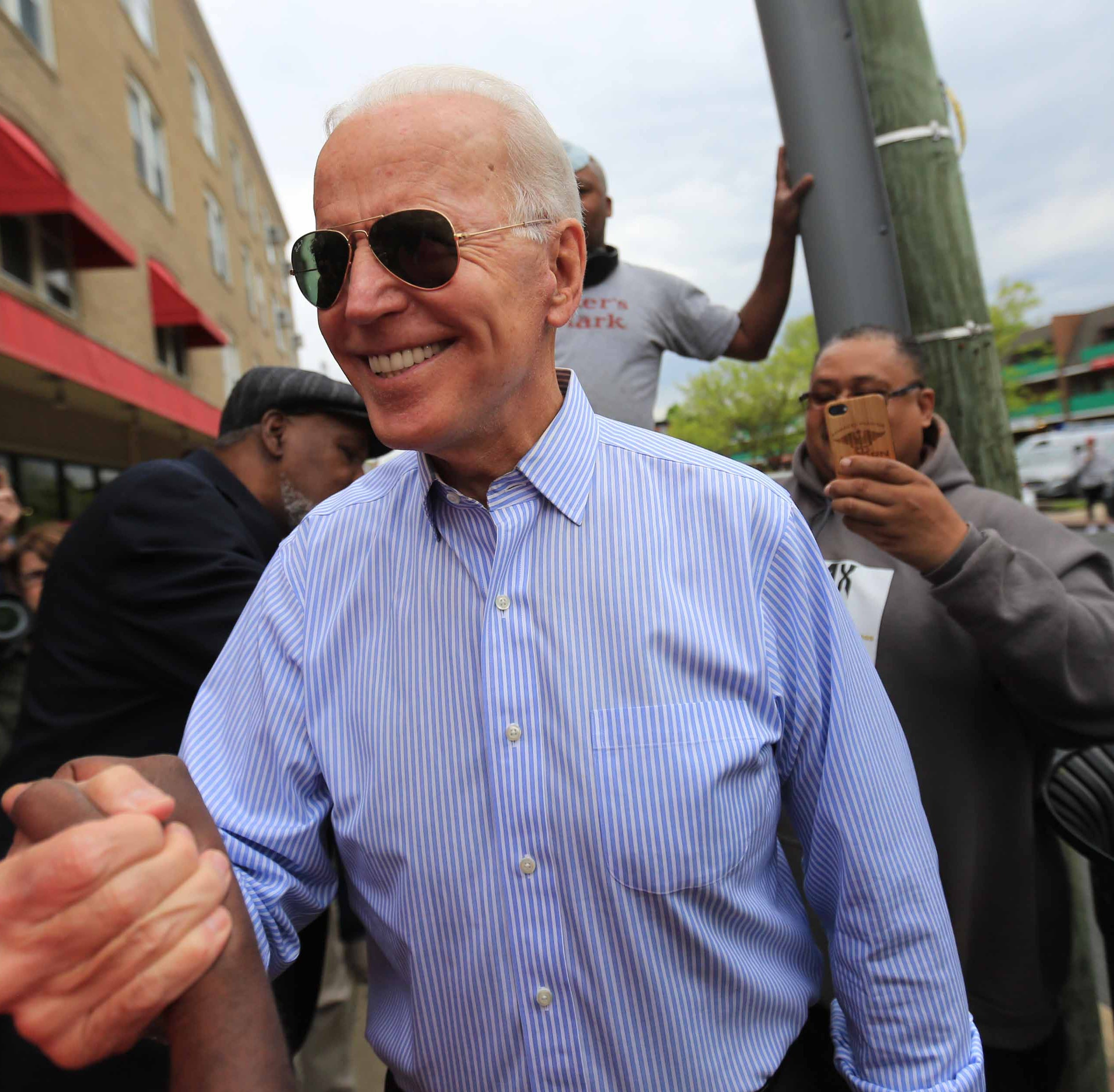 Vice President Biden shakes hands with an old friend outside of  Gianni's Pizza in Trolley Square on Thursday morning while surrounded by media.
