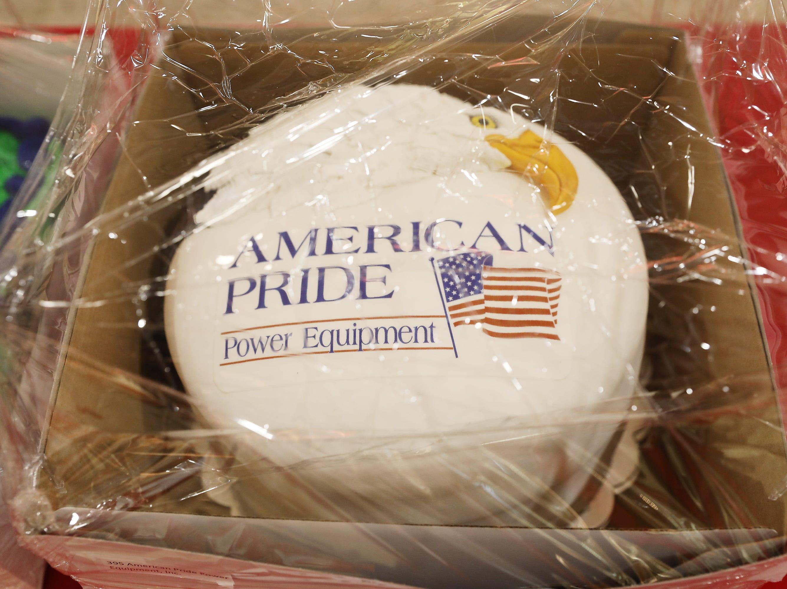 "5 P.M. Friday cake 395 American Pride Power Equipment - Cub Cadet CC800 33"" walk mower, electric start; $1,399"