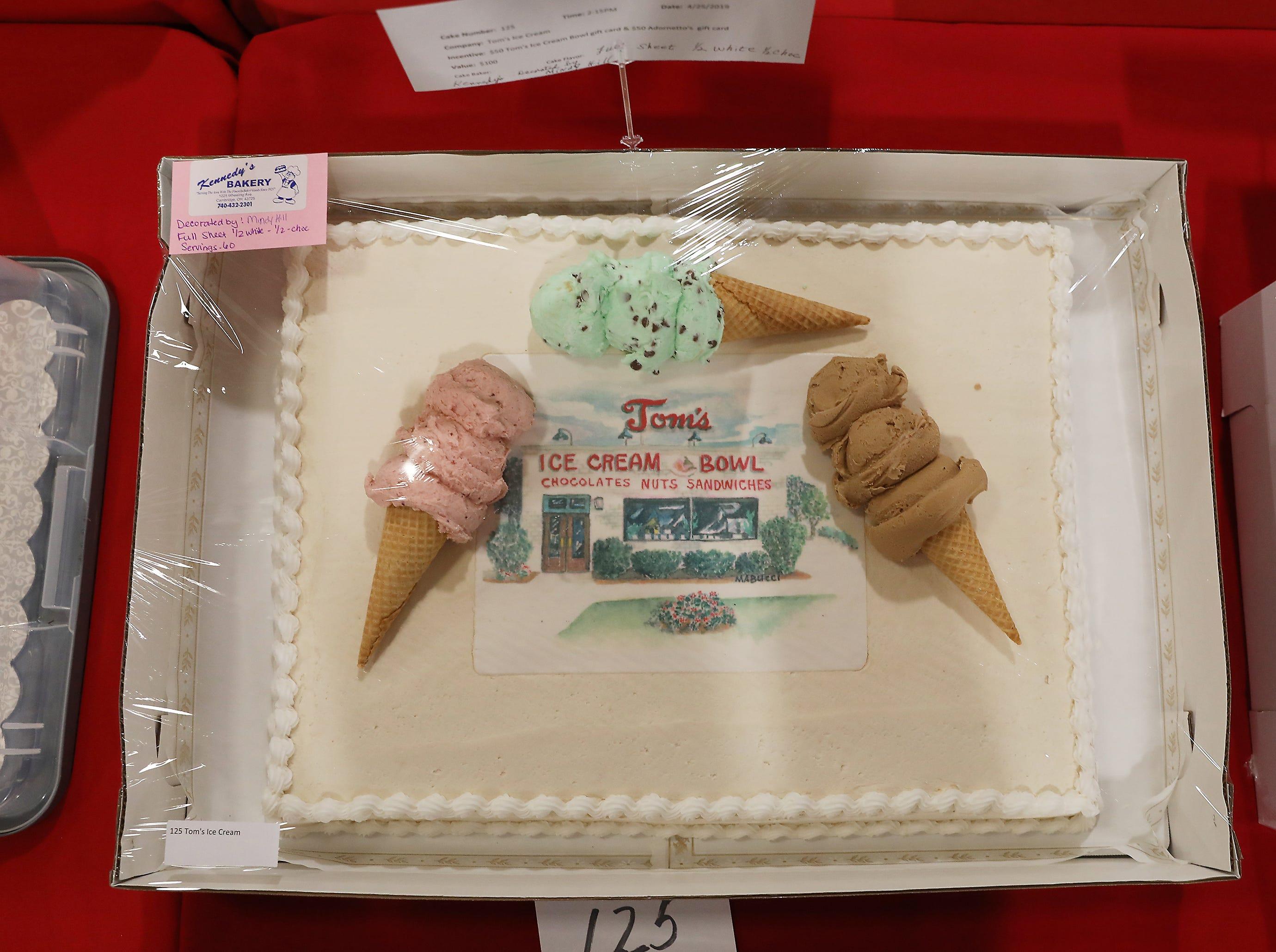 2:15 P.M. Thursday cake 125 Tom's Ice Cream - $50 cards to Tom's and Adornetto's