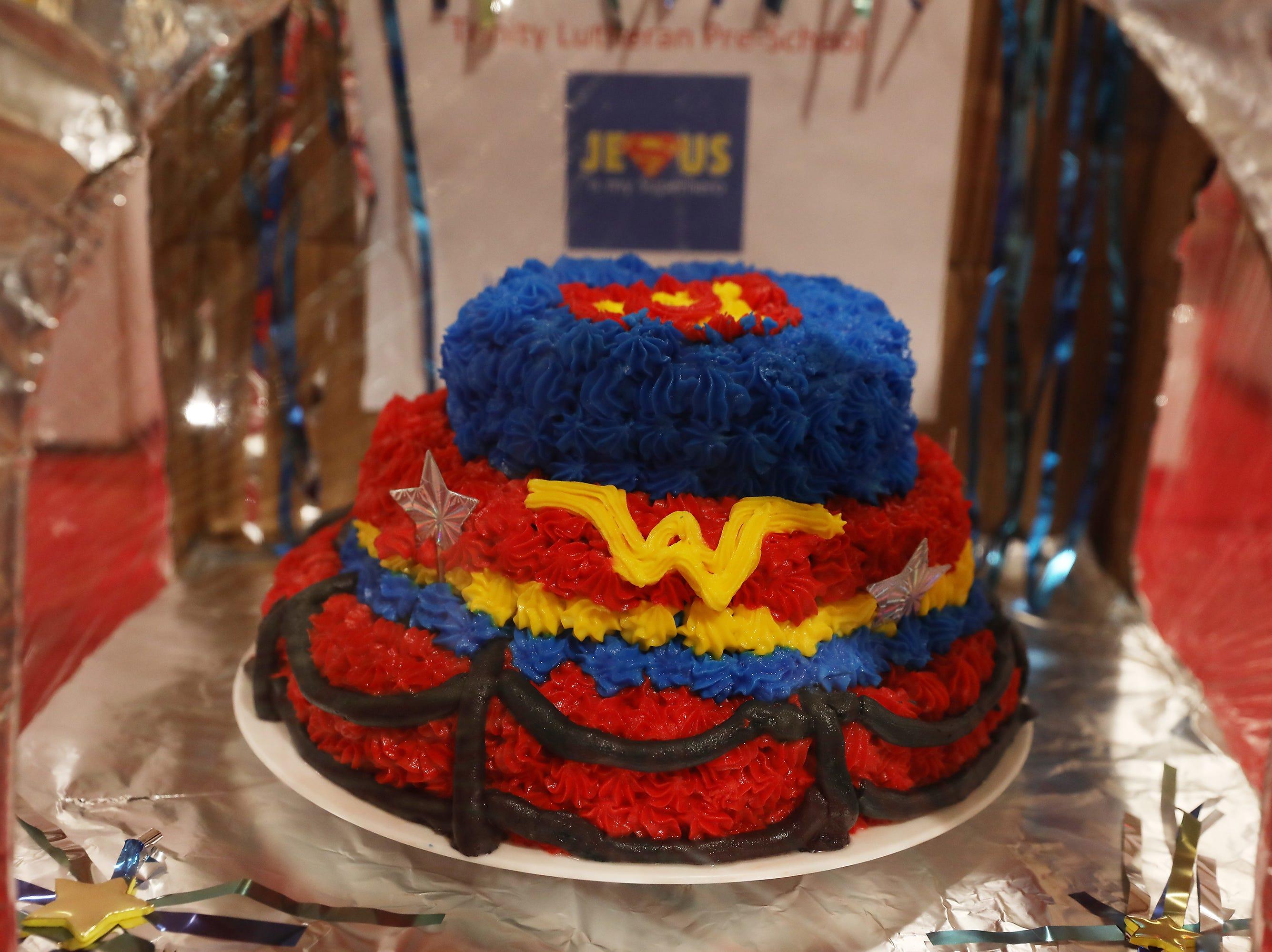 12:45 P.M. Thursday cake 91 Trinity Lutheran Church and Preschool - 2 Christian super hero print sets; $100