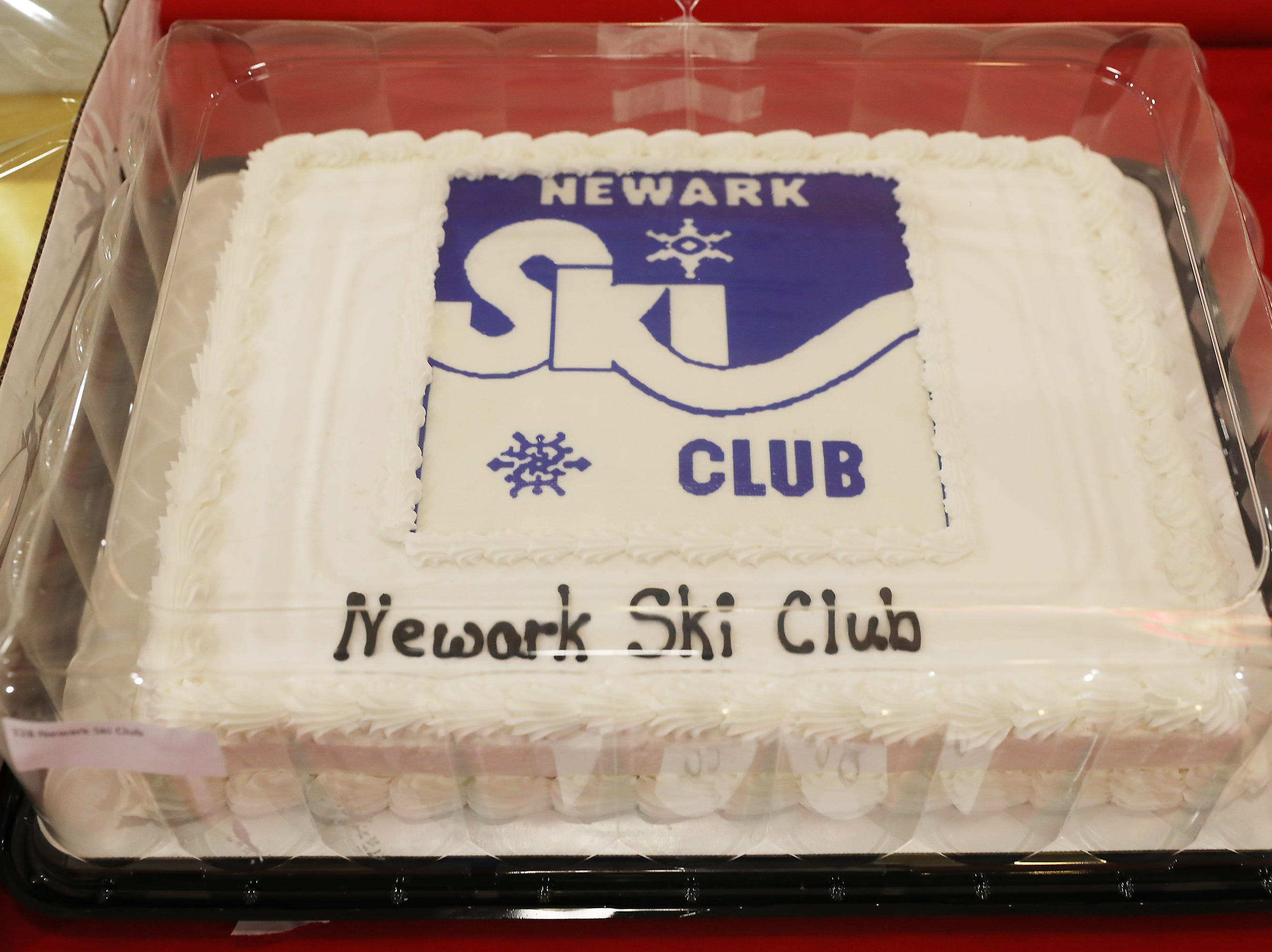2 P.M. Friday cake 328 Newark Ski Club - 2 memberships, 6 sandwiches at Dickey's BBQ, 2 bags of Godiva Chocolate, red wine from Oliver Winery, 4 wine glasses; $142