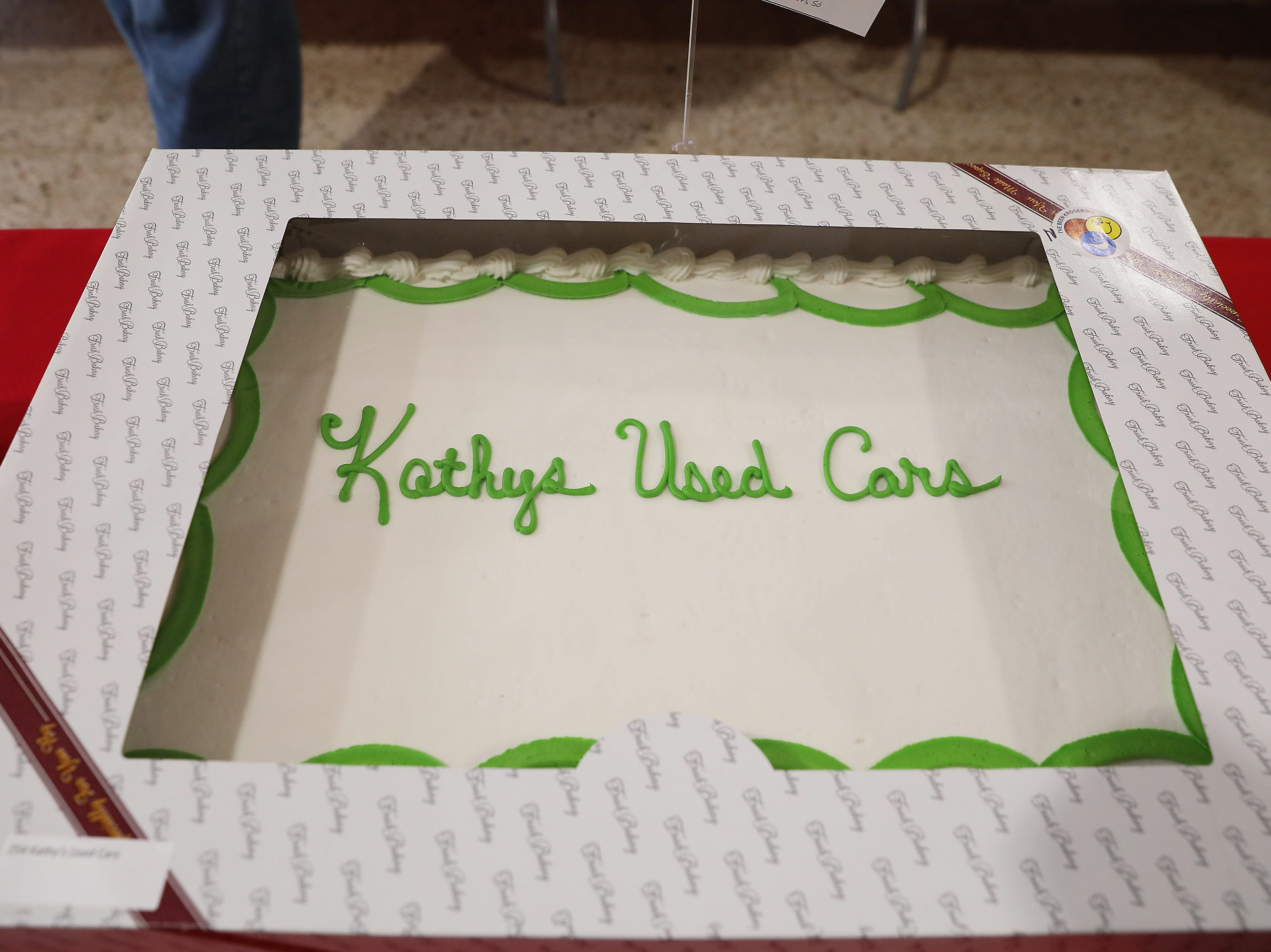 10 A.M. Friday cake 254 Kathy's Used Cars - $100 Kroger gift card