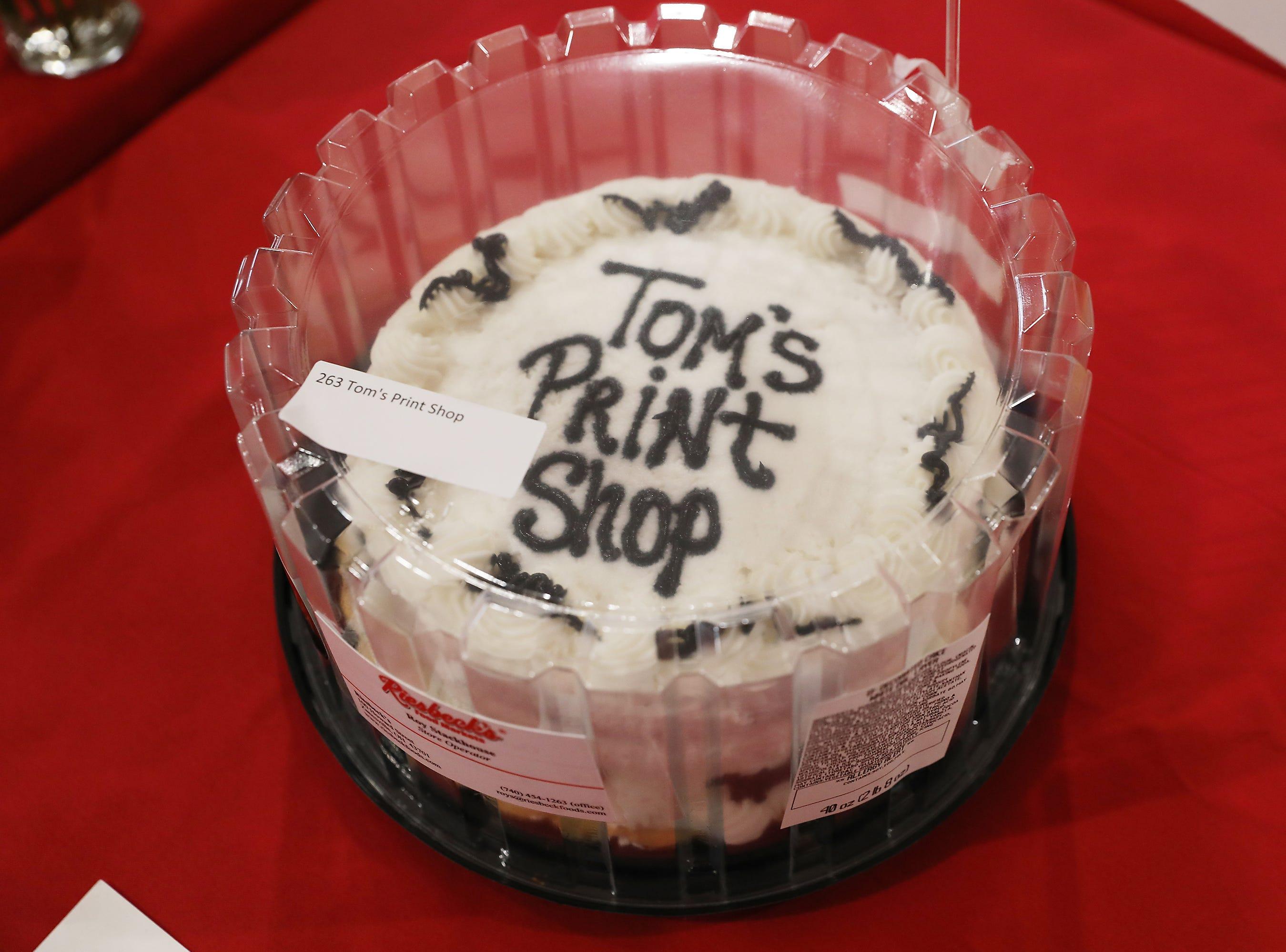 10:30 A.M. Friday cake 263 Tom's Print Shop - $25 Tom's Print gift card