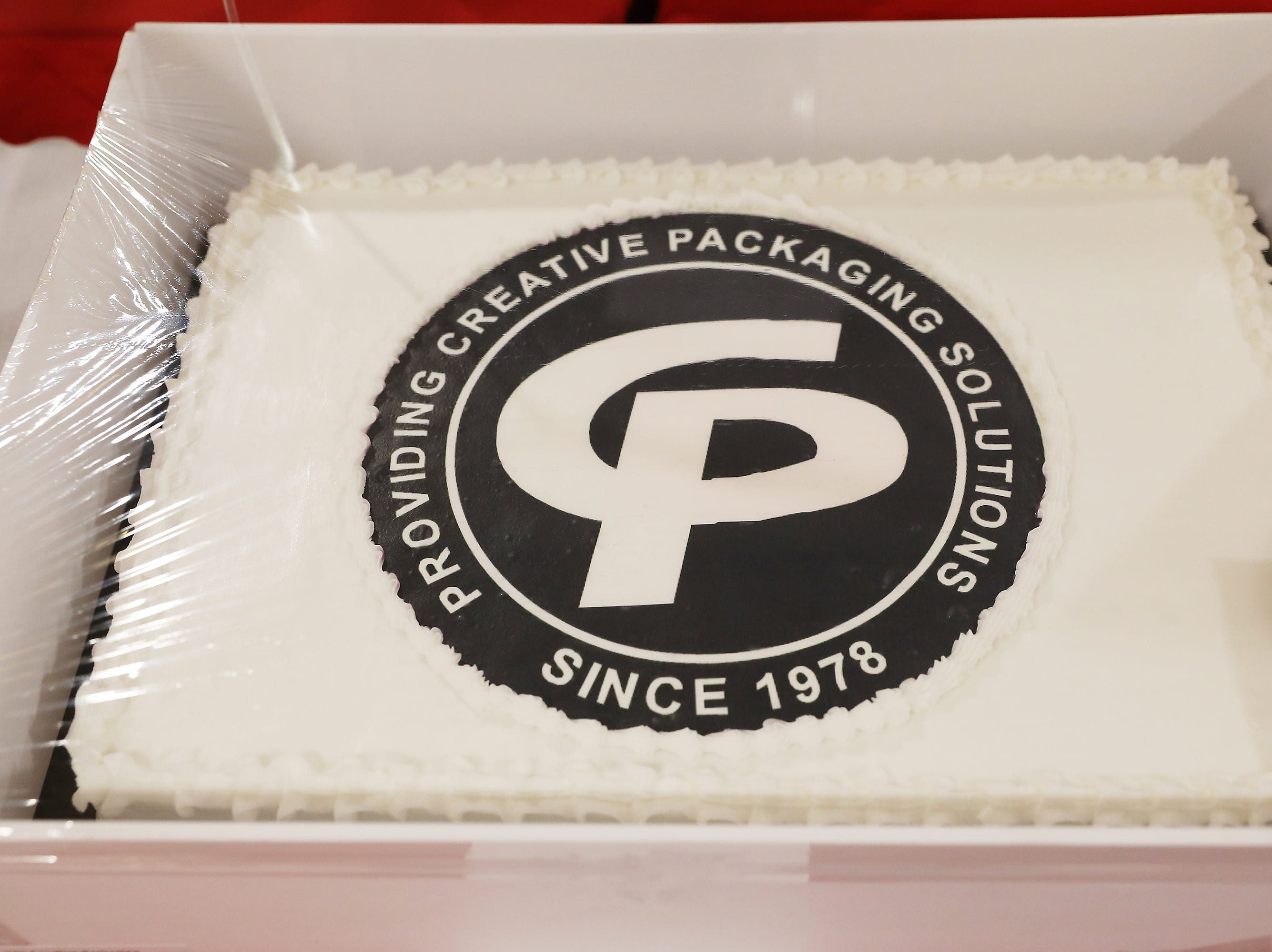 2:45 P.M. Friday cake 342 Creative Packaging - Flag pole with installation; $400