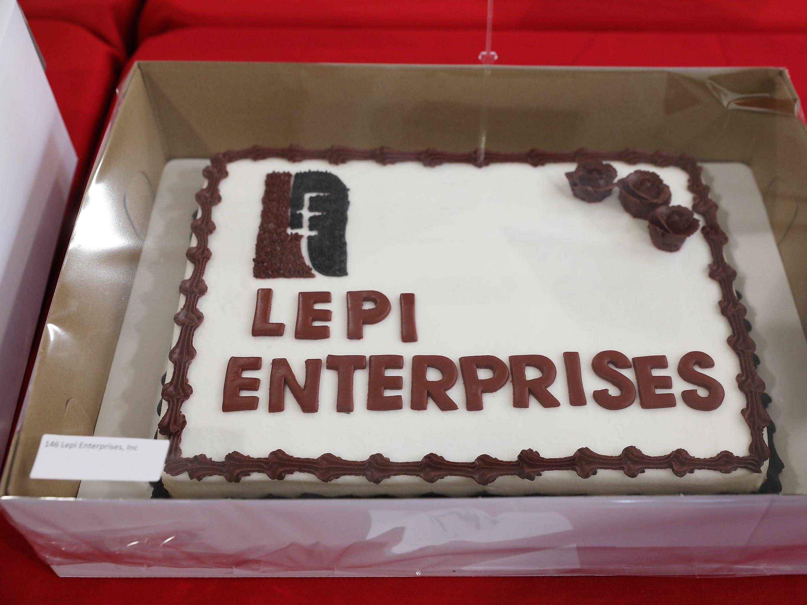 3:15 P.M. Thursday cake 146 Lepi Enterprises - 4 rounds of golf at Vista View, cart, golf balls, tees; $150