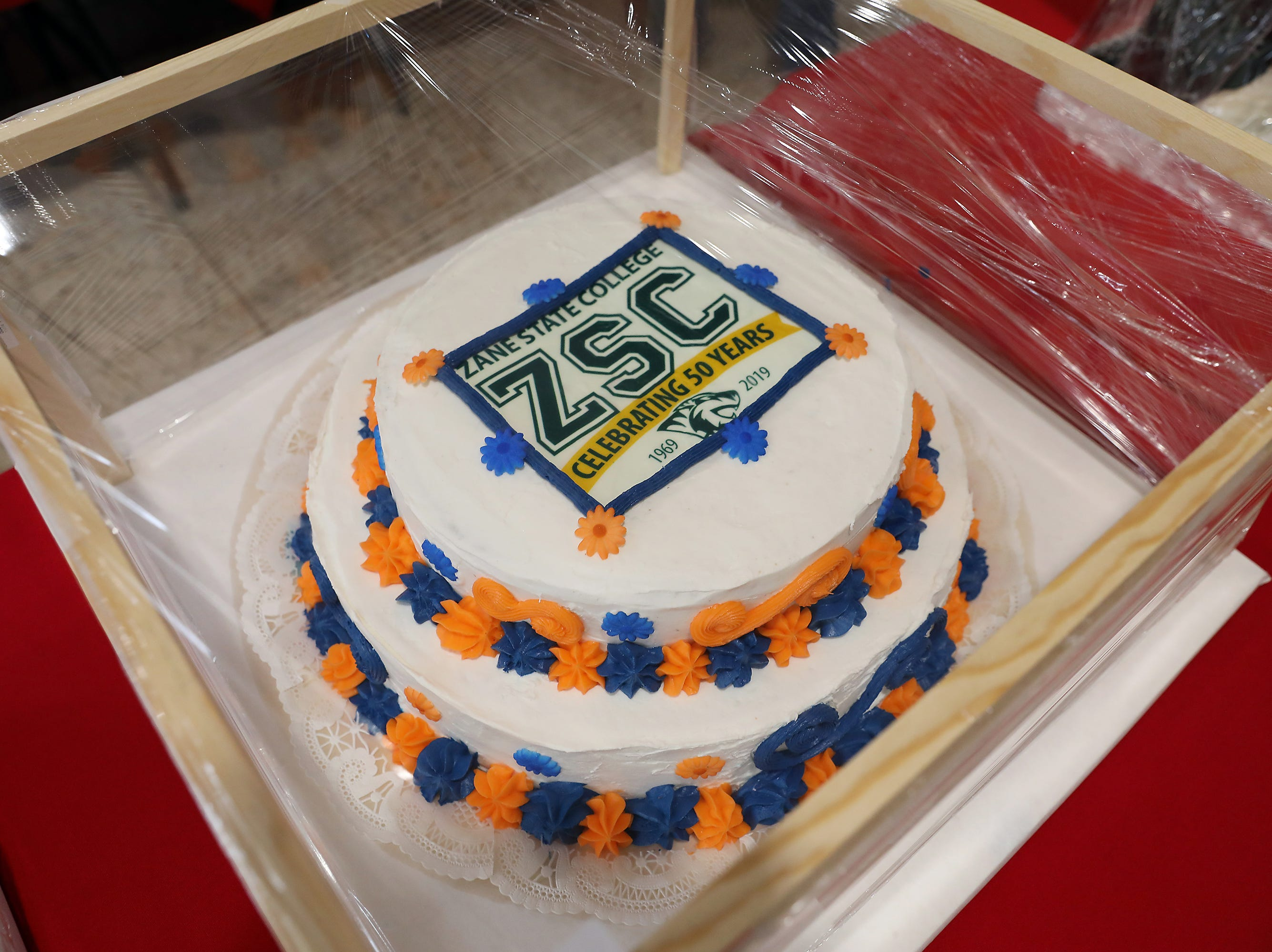 10 A.M. Thursday cake 45 Zane State College - Retro Zane State Tt-shirt, windbreaker, 50th anniversary commemorative merchandise; $75