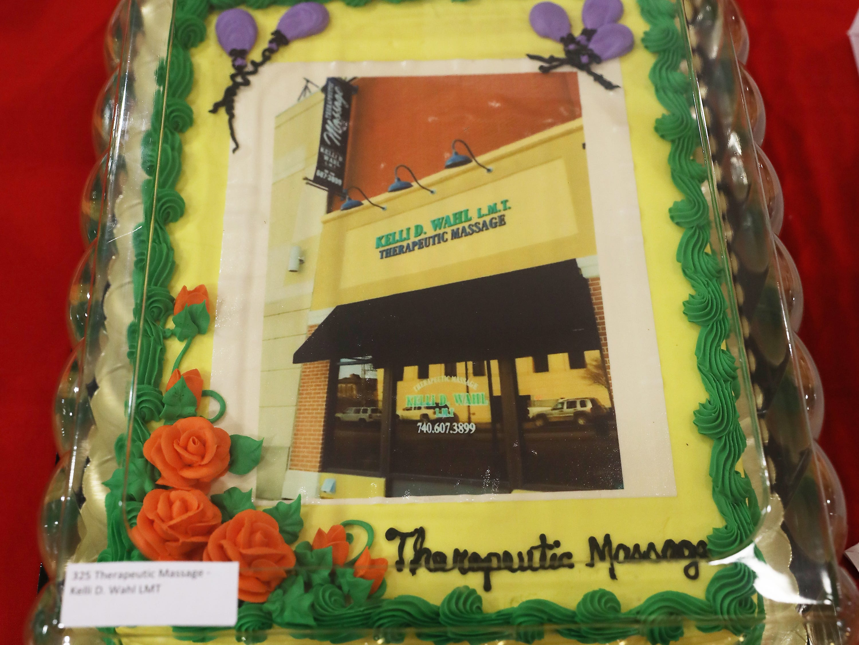 2 P.M. Friday cake 325 Therapeutic Massage Kelli D. Wahl LMT - 75 minute massage gift card, 2 handmade pottery pieces; $100
