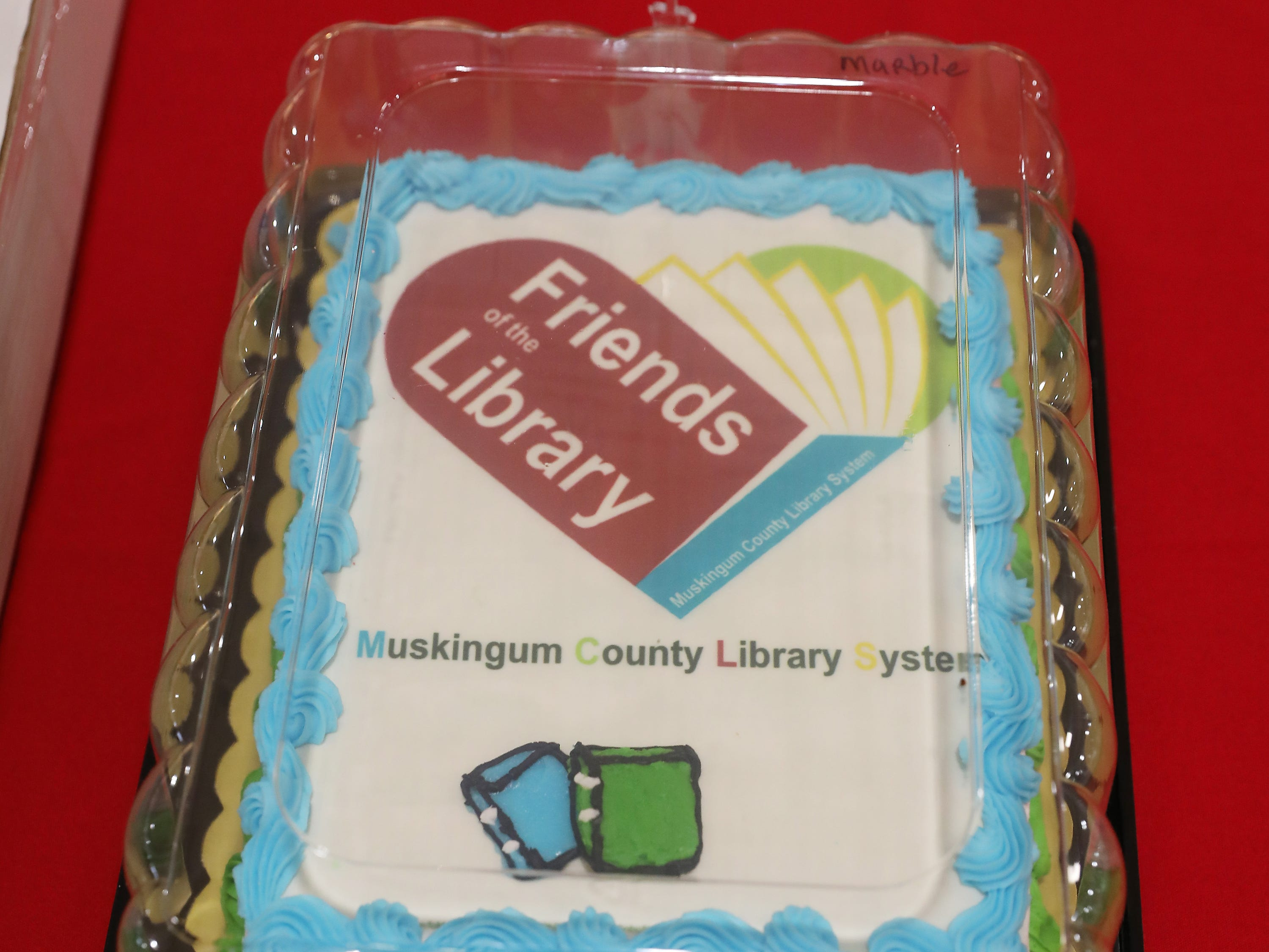 9:15 A.M. Friday cake 232 Muskingum County Library System - books, tablet, magnifying bookmark, membership in the Friends of the Library Volunteer Group; $150