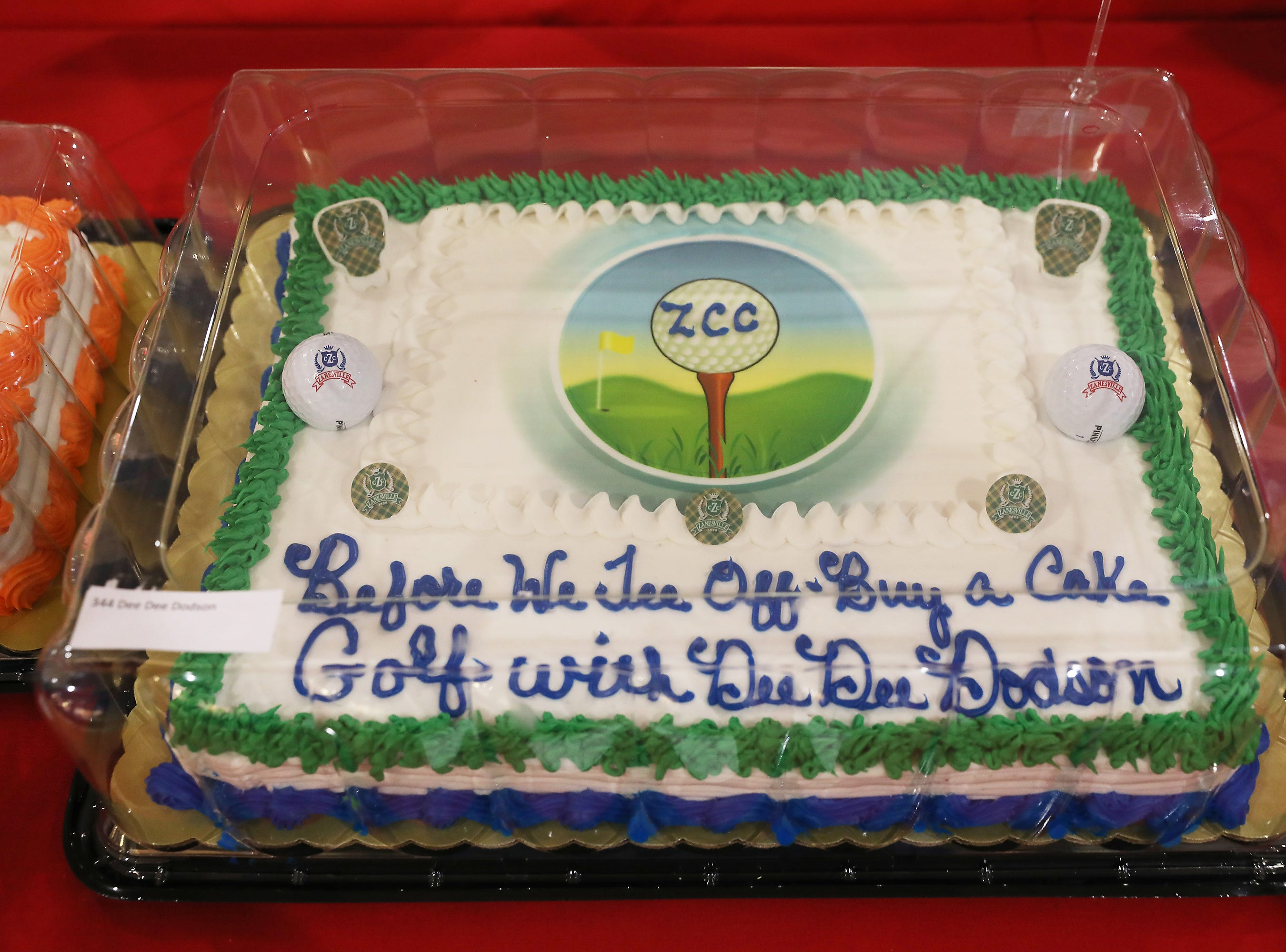 2:45 P.M. Friday cake 344 Dee Dee Dodson - 18 holes of golf at the Zanesville Country Club with Dee Dee, ZCC golf cart towel