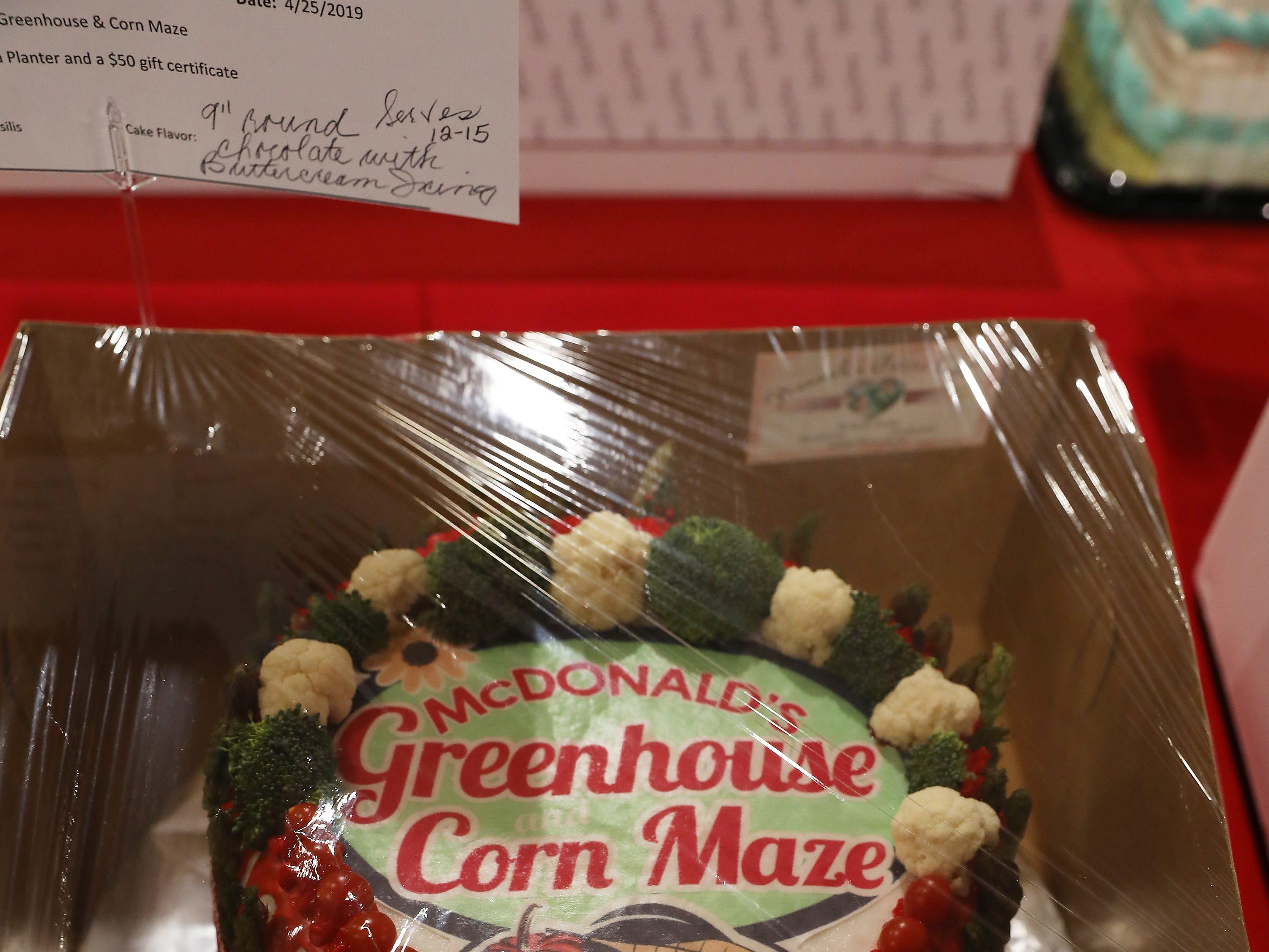 "2:15 P.M. Thursday cake 126 McDonald's Greenhouse & Corn Maze - 16"" salsa planter, $50 gift certificate"