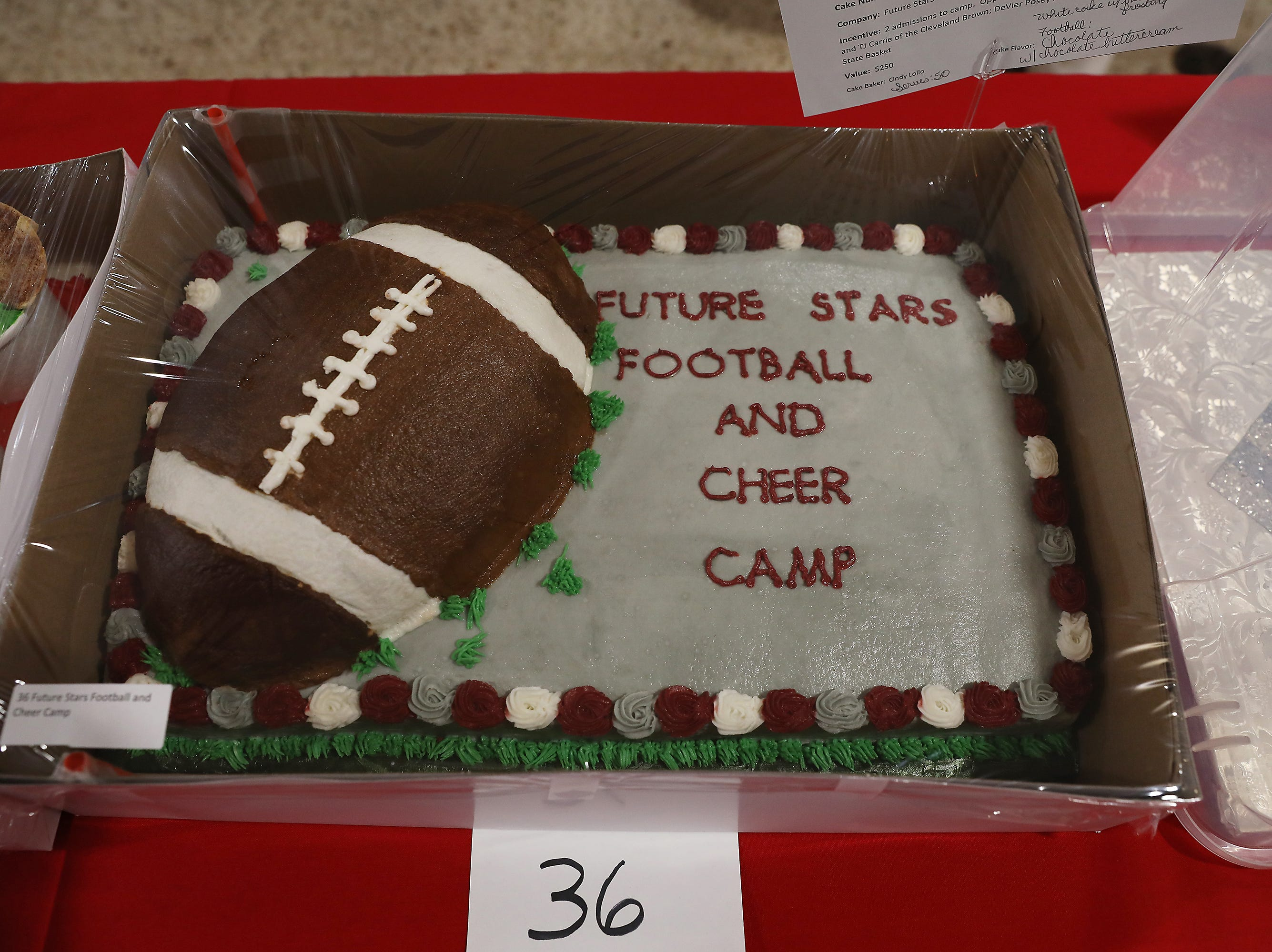 9:45 A.M. Thursday cake 36 Future Stars Football and Cheer Camp - 2 admissions to camp with former Buckeyes and TJ Carrie of the Cleveland Brown, DeVier Posey autograph jersey, Ohio State Basket; $250