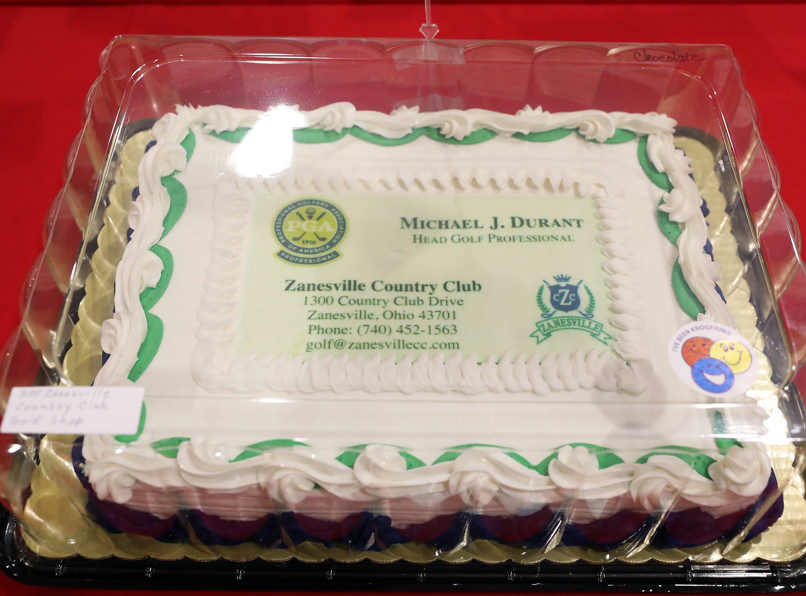 1 P.M. Friday cake 305 Zanesville Country Club Golf Shop - Mizund Cue Hybrid 22 degree Loff, Stiff flex, right handed